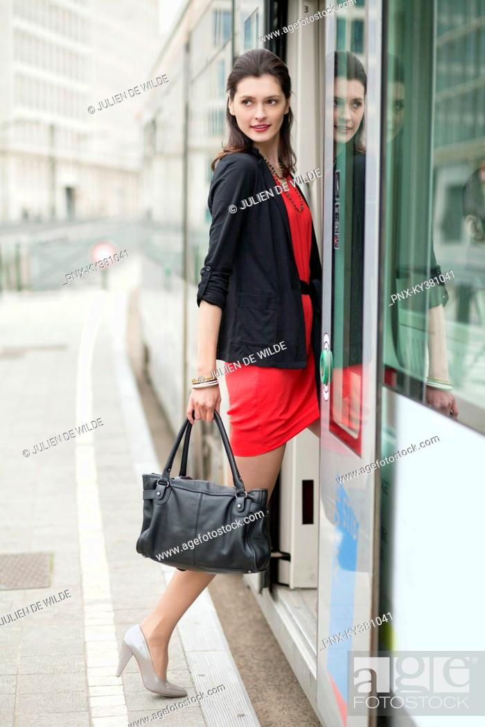 Stock Photo: Woman boarding a bus.