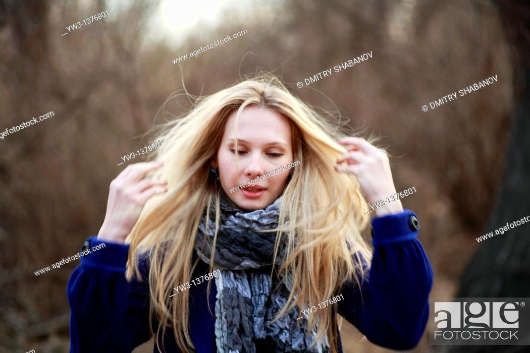Stock Photo: Portrait of beautiful woman in autumn in blue coat.