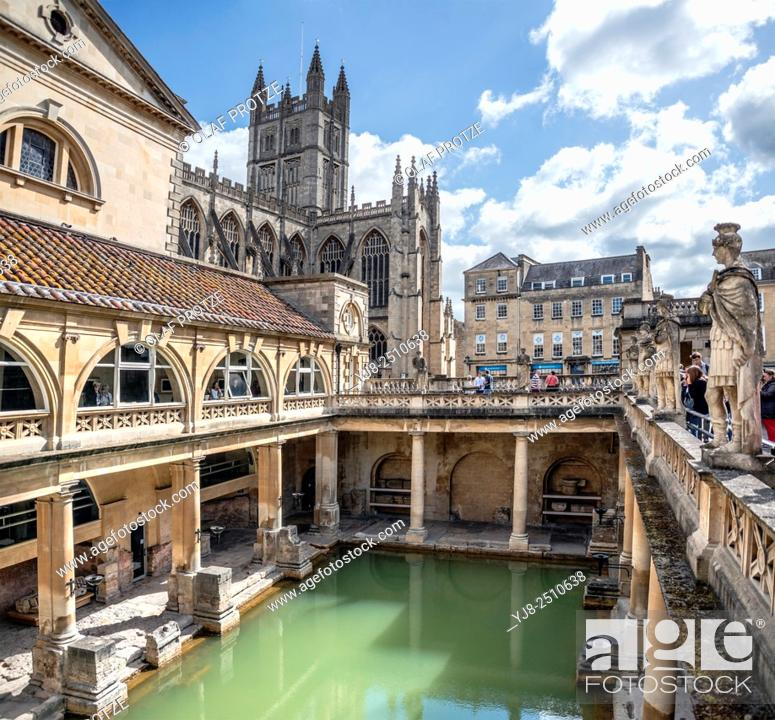 Stock Photo: The Roman Baths complex, a site of historical interest in the English city of Bath with the cathedral in the background, Somerset, England.