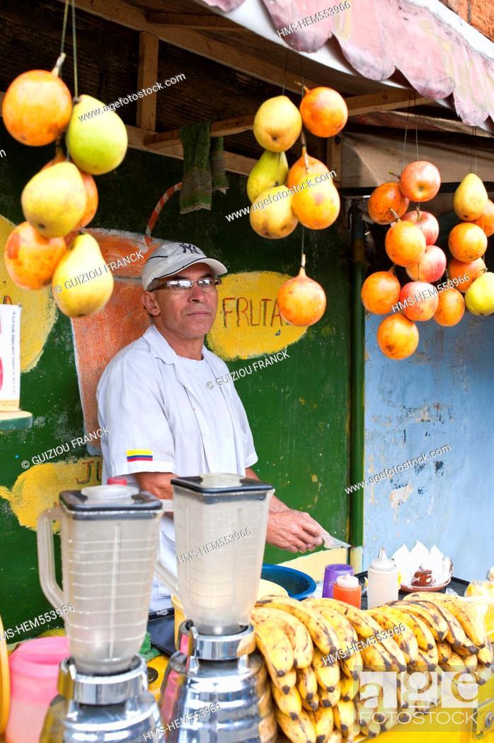Stock Photo: Colombia, Antioquia Department, Medellin, Santo Domingo Savio District inhabited by poor families favela, fruit juice salesman.