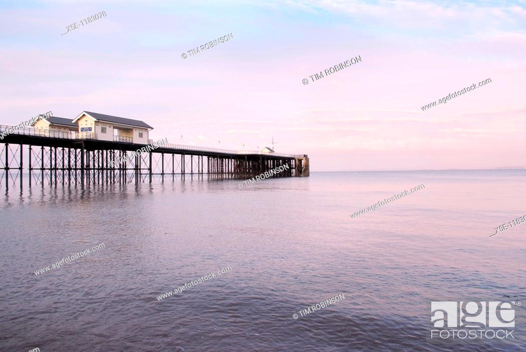 Stock Photo: Pier at Penarth, Wales, at sunset with calm sea.