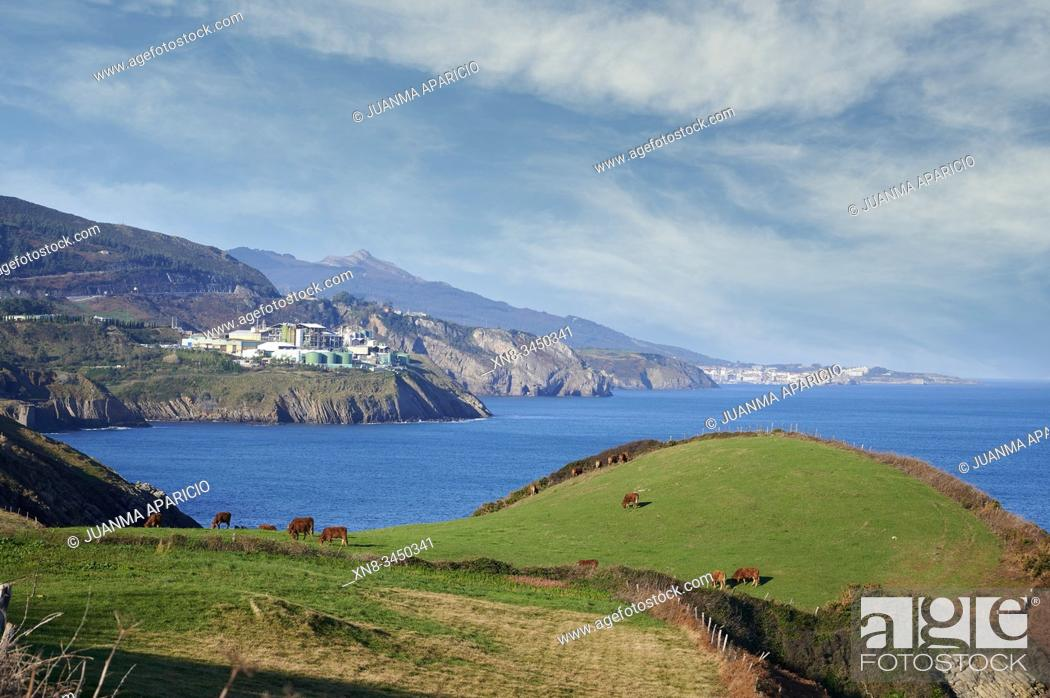 Stock Photo: Derivados del Fluor factory, Fluorine Chemical Industry and Old Mineral Load in the Cliff, Ontón, Castro Urdiales, Cantabria, Spain.