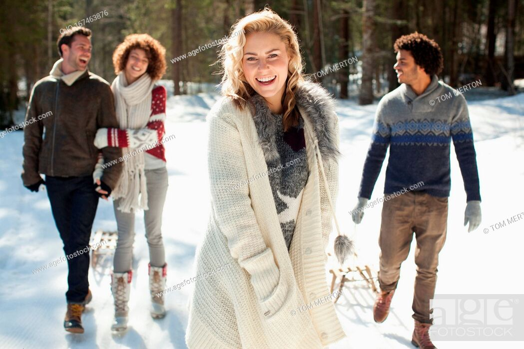 Stock Photo: Two couples walking in snow.