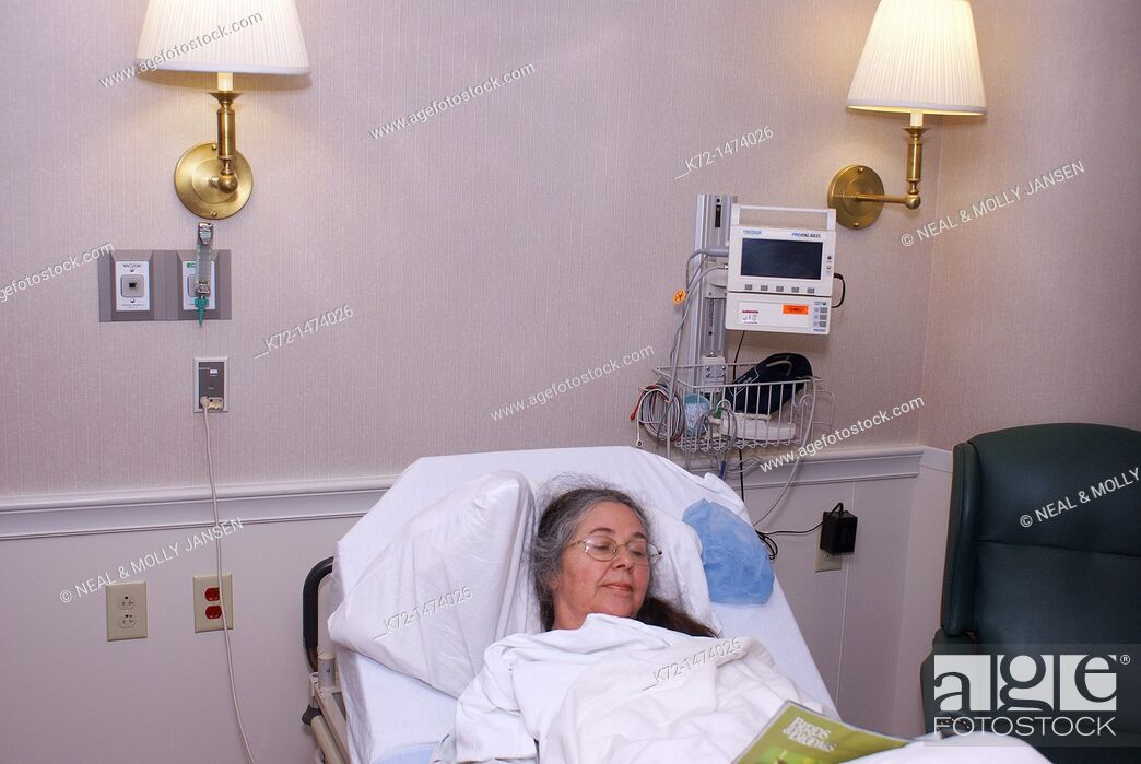 Stock Photo: Elderly Woman in Hospital Bed.