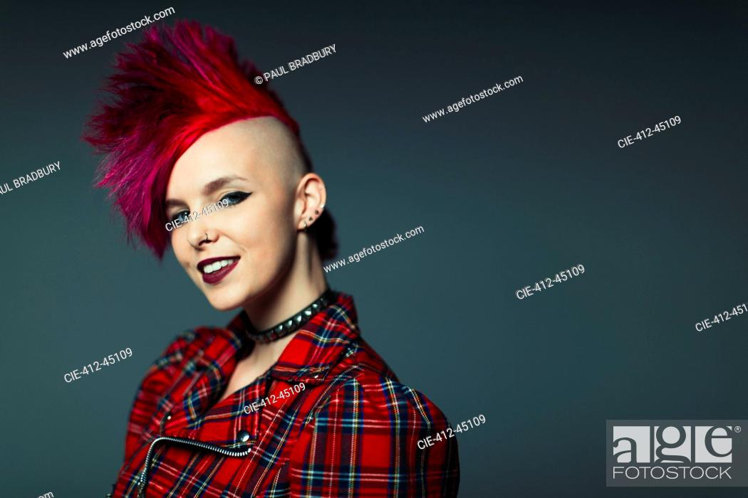 Stock Photo: Portrait confident, cool young woman with pink mohawk.