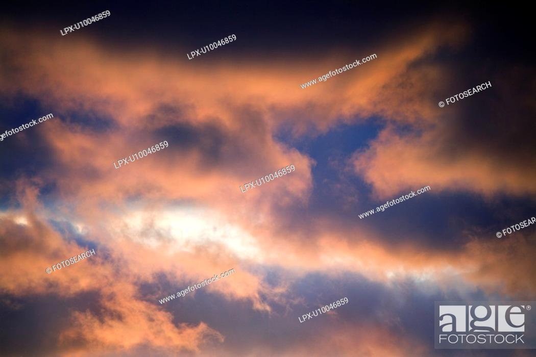 Stock Photo: Red clouds in blue sky at sunset in Maui, Hawaii, USA.