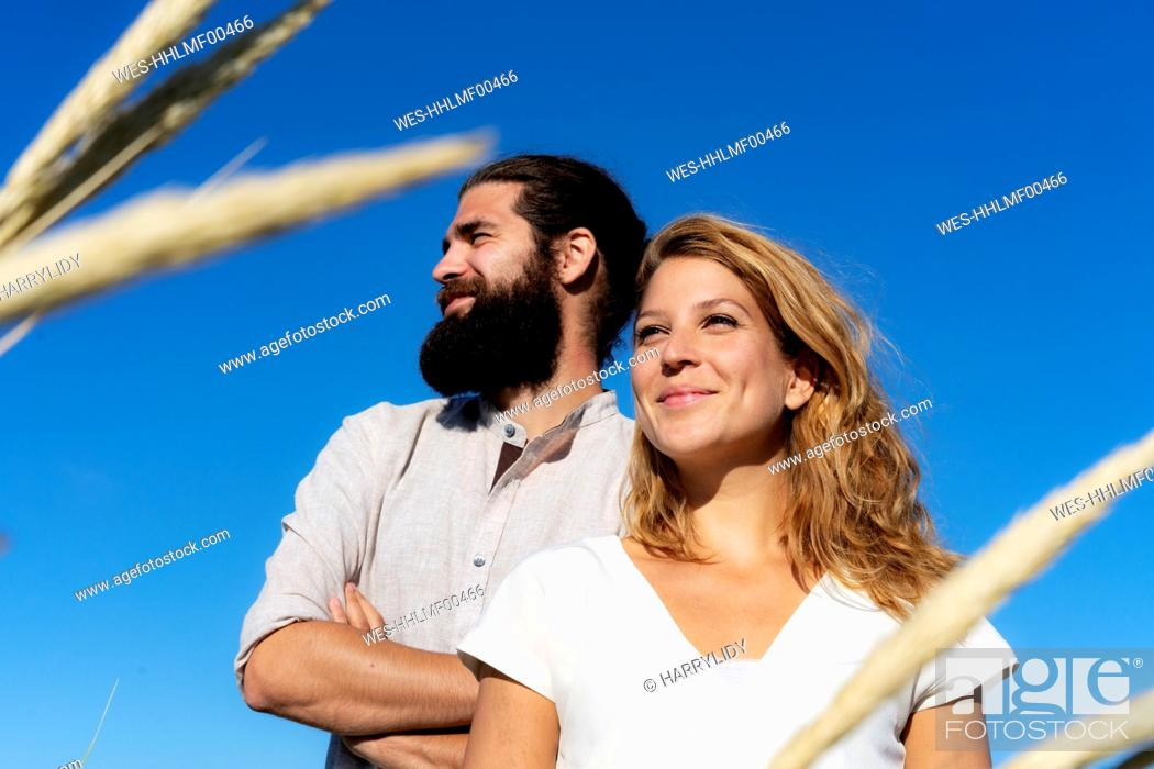 Photo de stock: Confident couple spending time in nature.