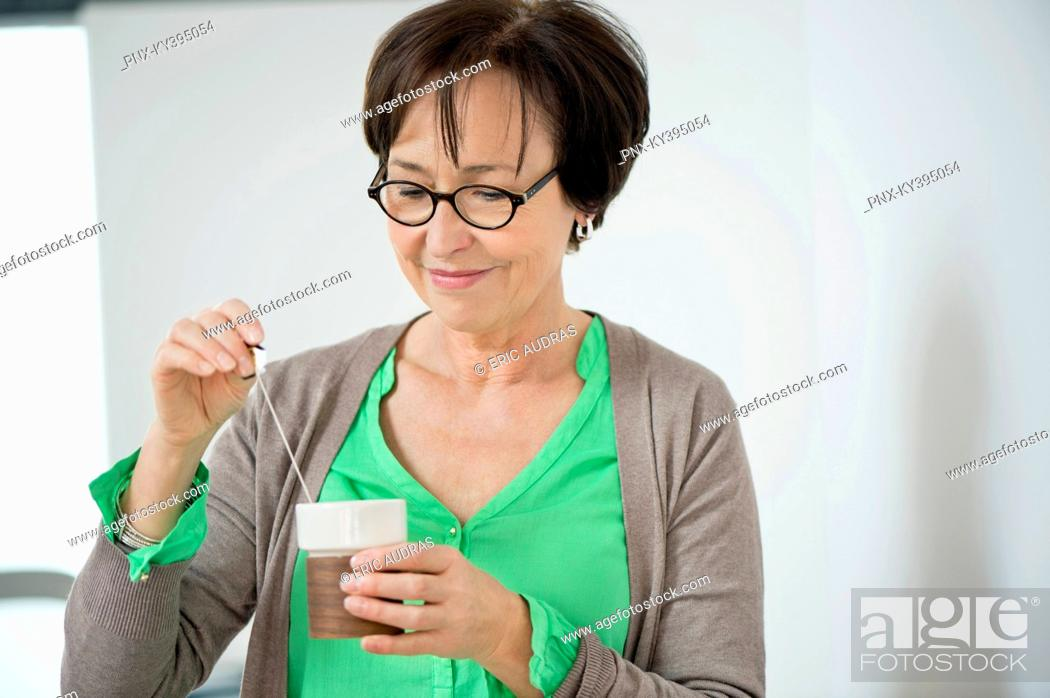 Stock Photo: Close-up of a woman having coffee.