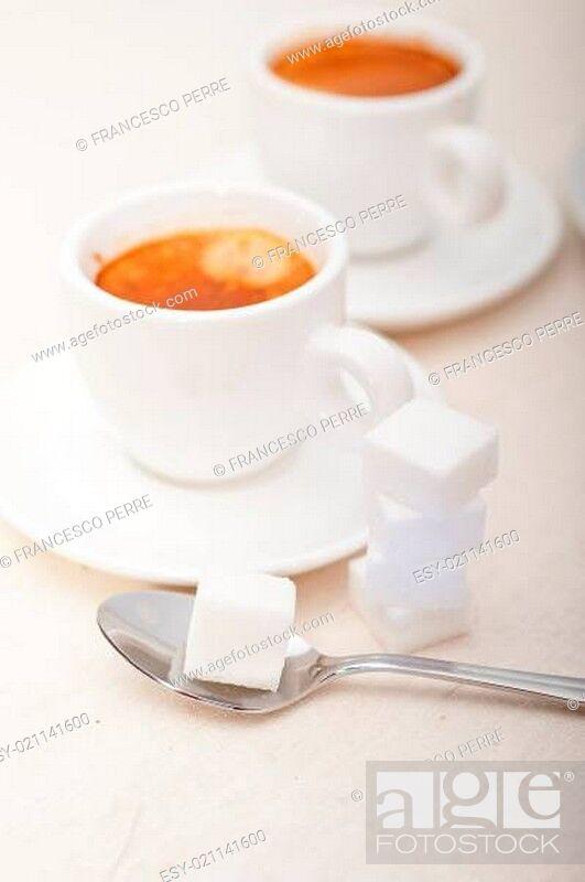Stock Photo: Italian espresso coffee and sugar cubes.