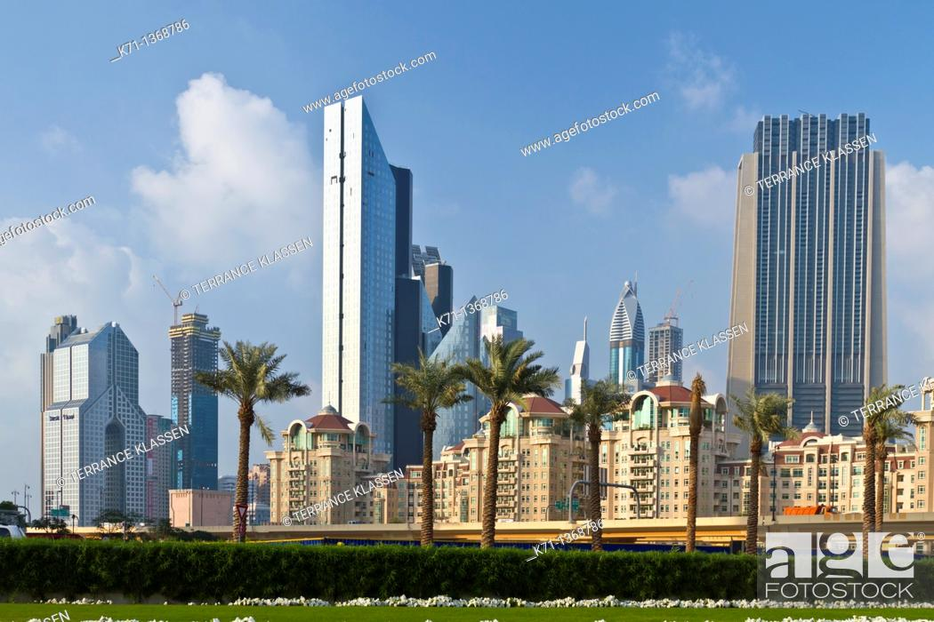 Stock Photo: The Dubai city skyline near the Dubai Mall, UAE.