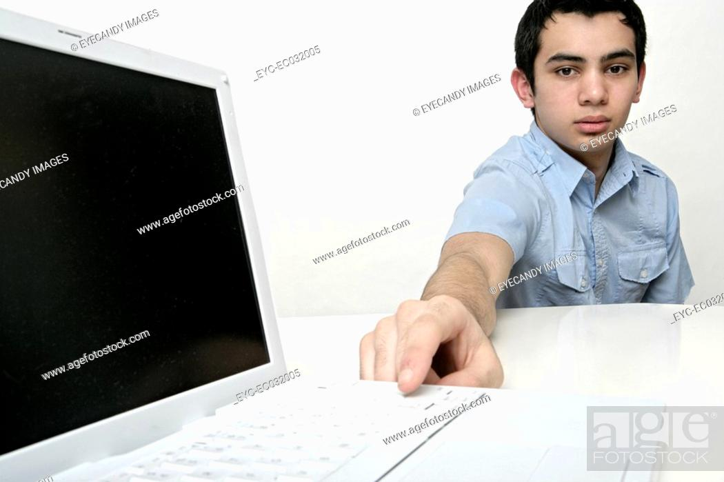 Stock Photo: View of a teenage boy with his laptop.