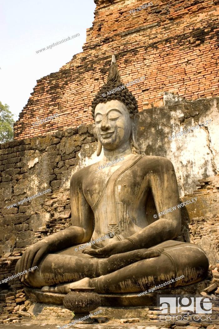 Stock Photo: Seated Buddha statue Sukhothai historic temples site Thailand.