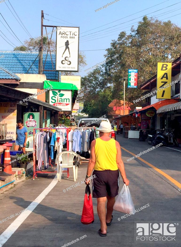 Stock Photo: 08 February 2020, Thailand, Pattaya: A man walks down a street. The Thai coastal city attracts many Germans, including holidaymakers and pensioners.