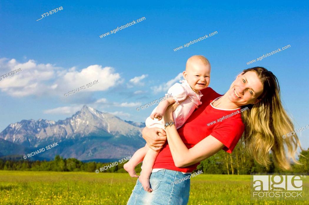 Stock Photo: mother with her baby girl, Krivan, Vysoke Tatry High Tatras, Slovakia.