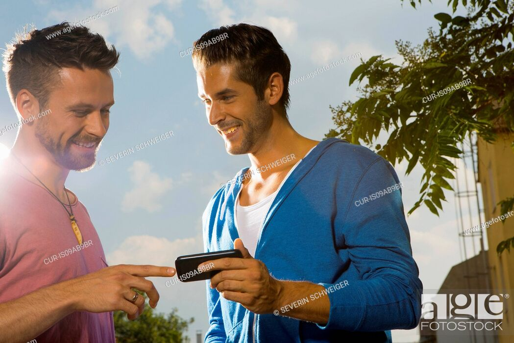 Stock Photo: Two men with cell phone.