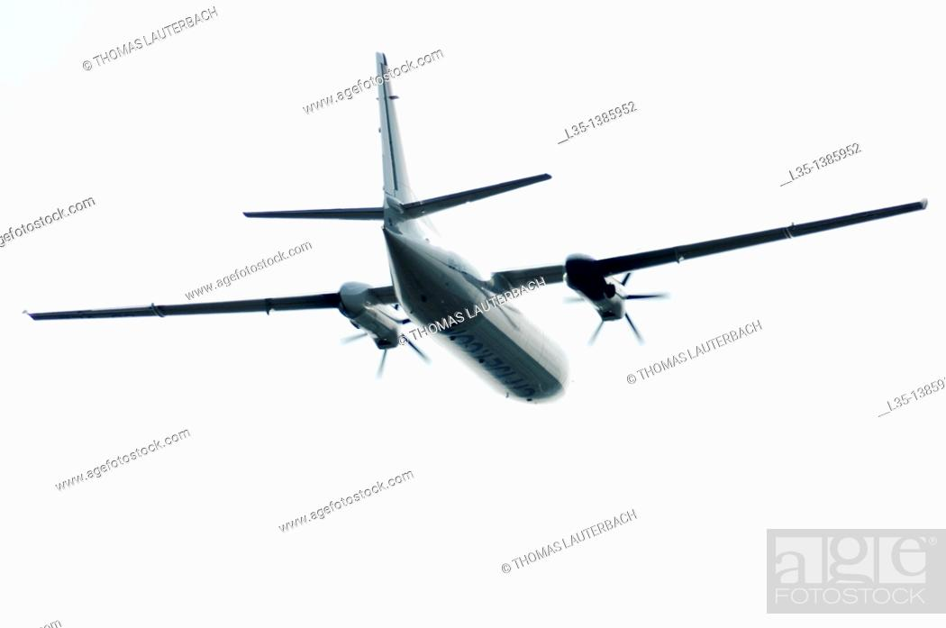 Stock Photo: Turboprop aircraft in bright sky.