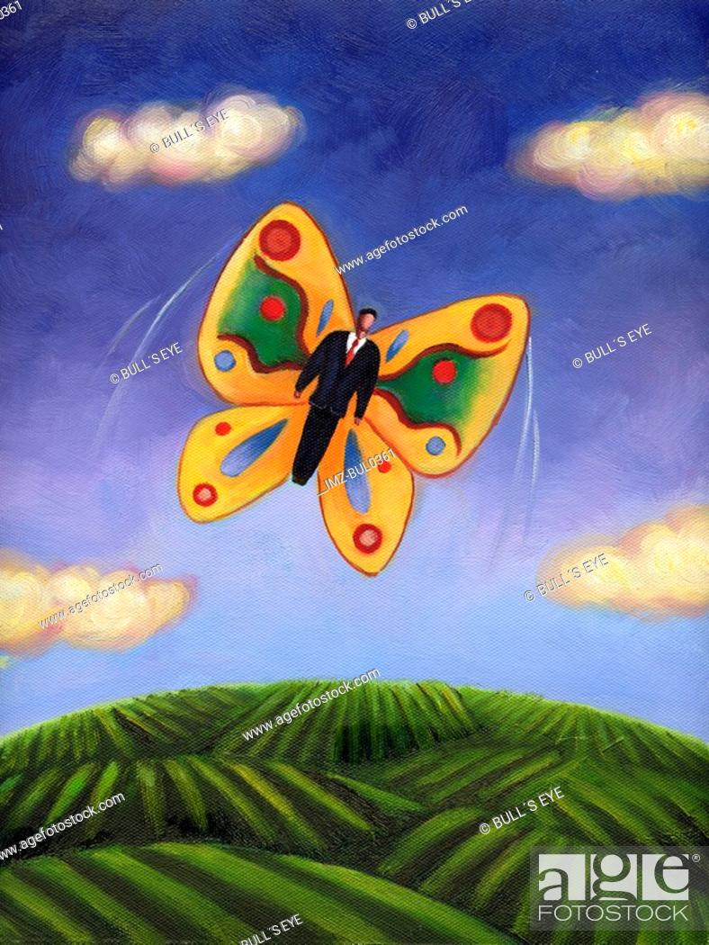 Stock Photo: A businessman with butterfly wings flying in the sky.