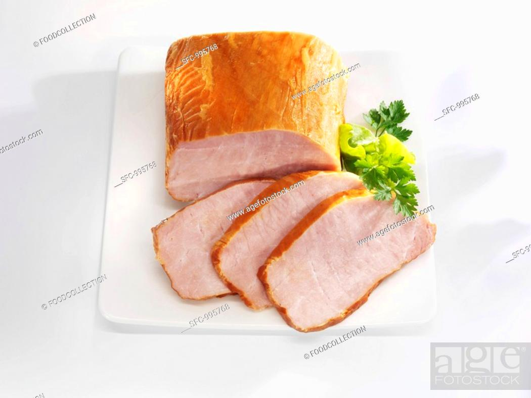 Stock Photo: Smoked, cured loin of pork partly sliced.