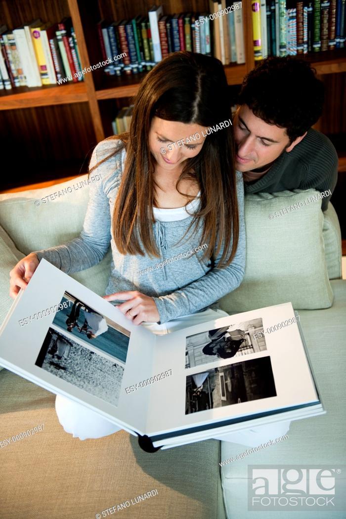 Stock Photo: Couple looking at their wedding photo album.