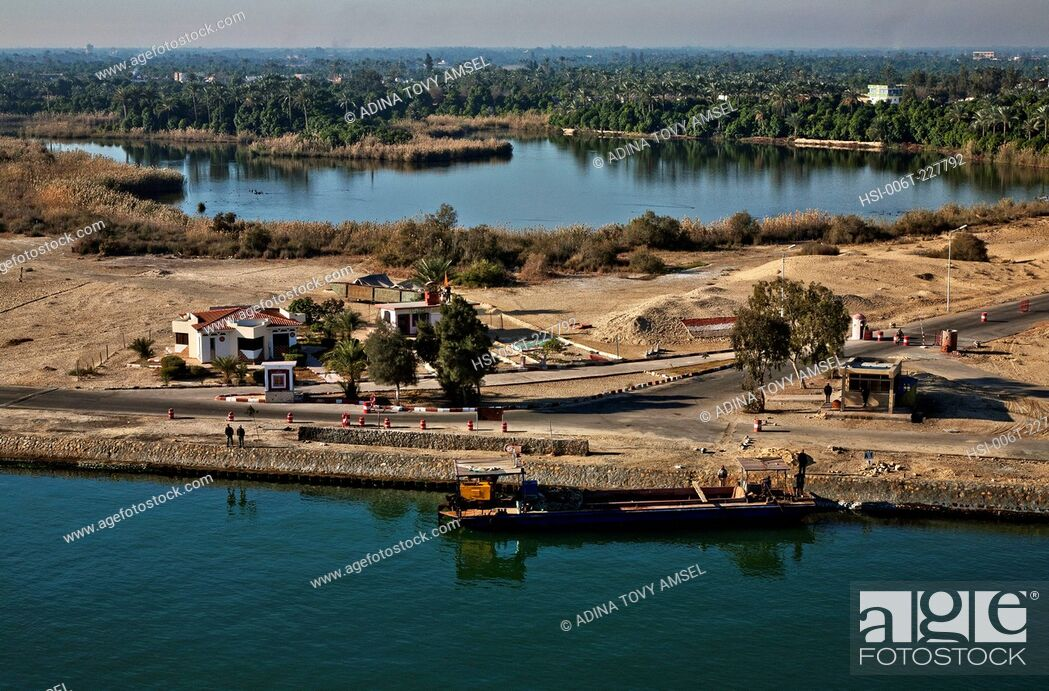 Stock Photo: Middle East. Egypt. Suez Canal. Border post. Boat.