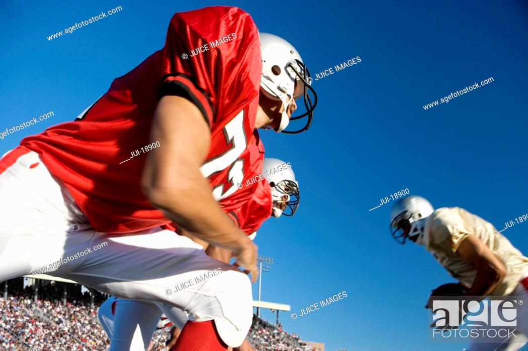 Stock Photo: Defensive lineman at line of scrimmage.