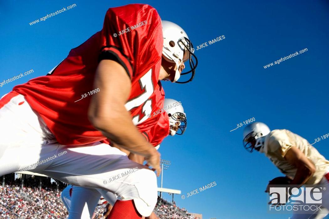 Stock Photo: Defensive lineman at line of scrimmage.