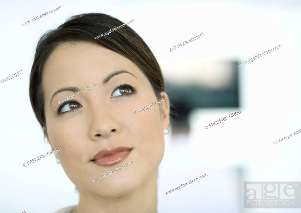 Stock Photo: Woman looking away, close-up of face.