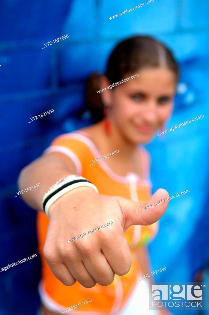 Stock Photo: Cute teenager makes hand poses.