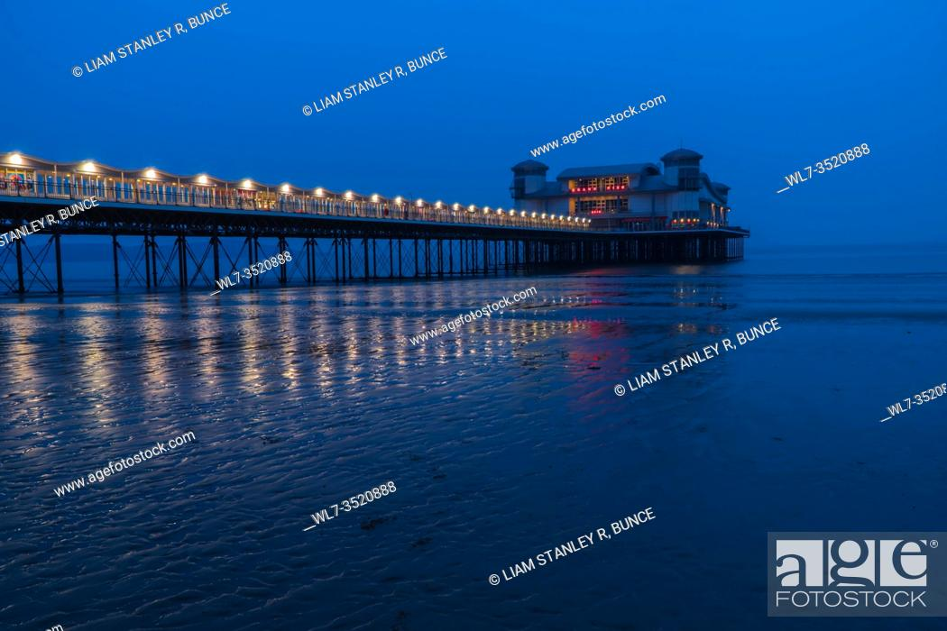 Stock Photo: The Grand Pier reaching out into the Bristol Channel at Weston-super-Mare, Somersert England UK. April 2019.