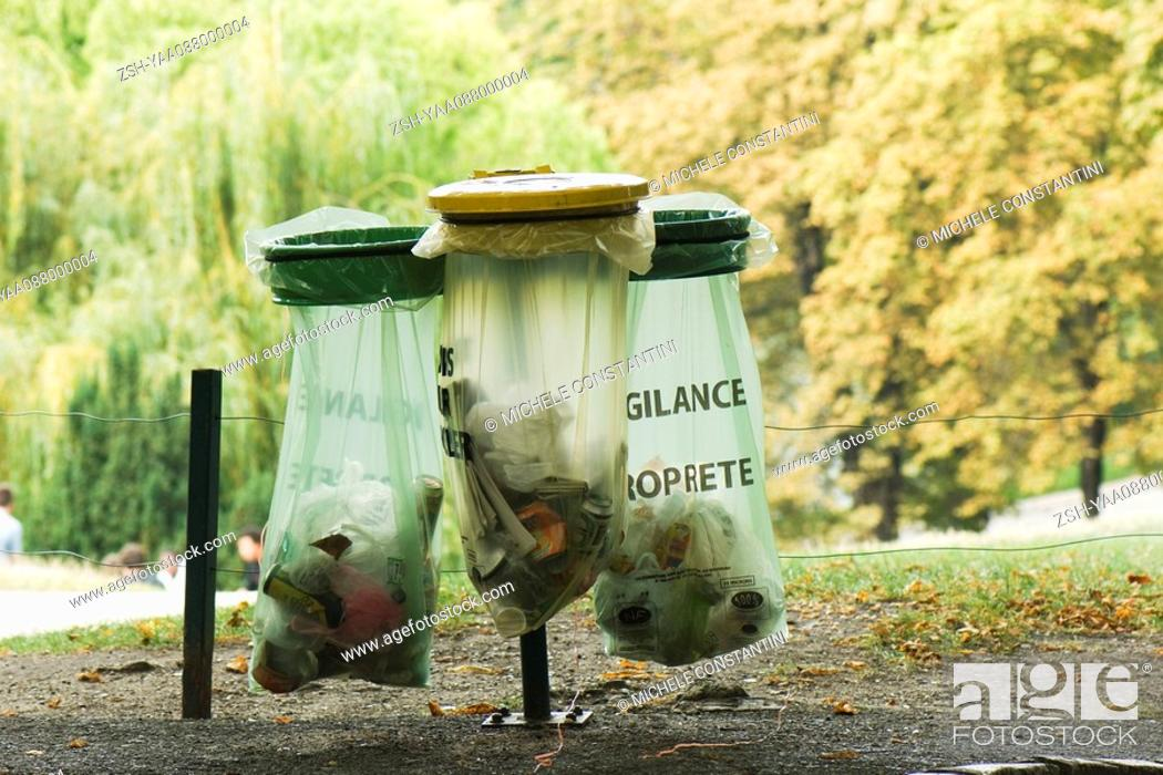Stock Photo: France, Paris, garbage receptacles in park.