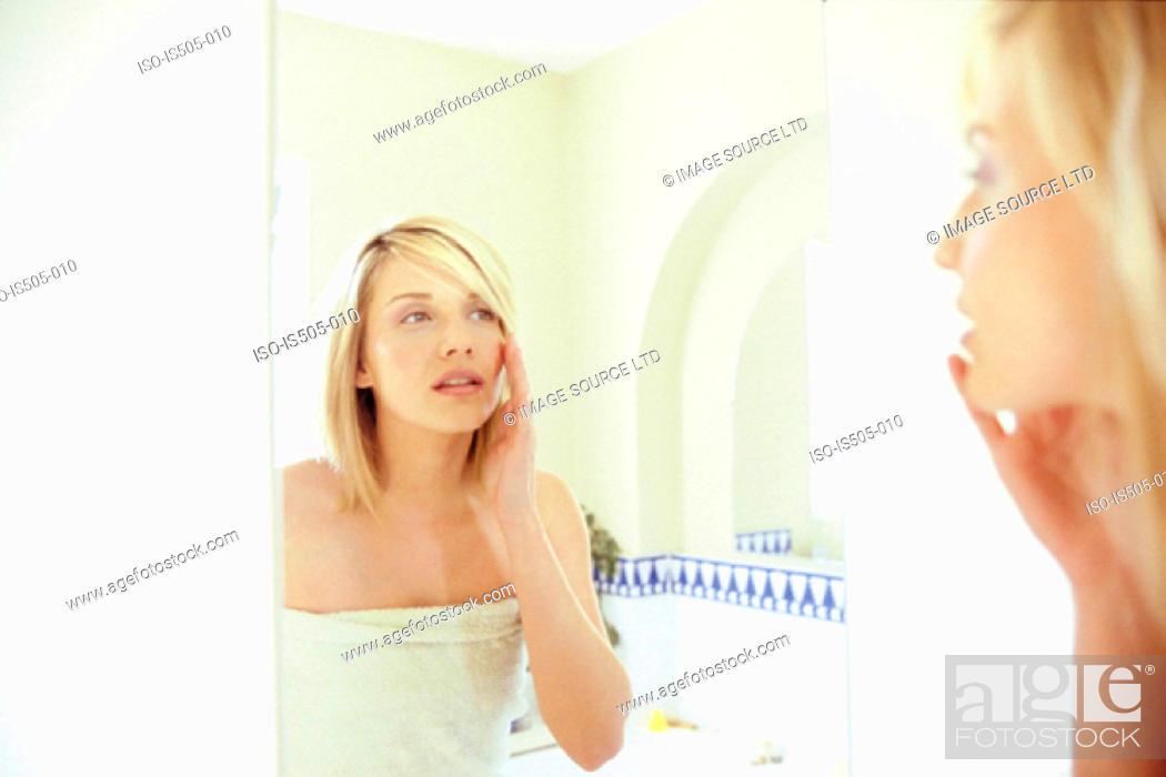 Stock Photo: Woman applying makeup.