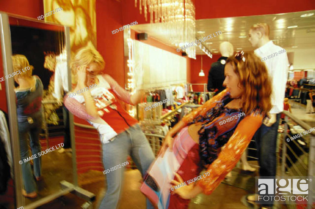 Stock Photo: Girls in clothes shop.