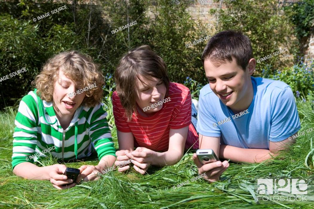 Stock Photo: Friends using their cell phones.