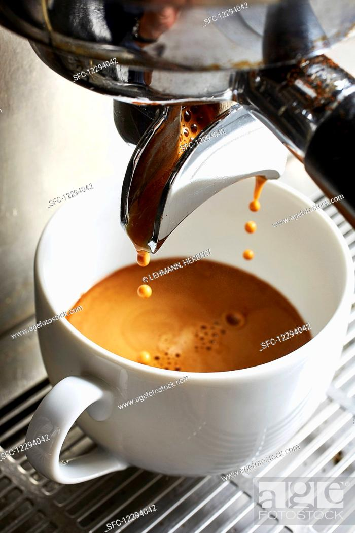 Stock Photo: Coffee dripping from a coffee machine.