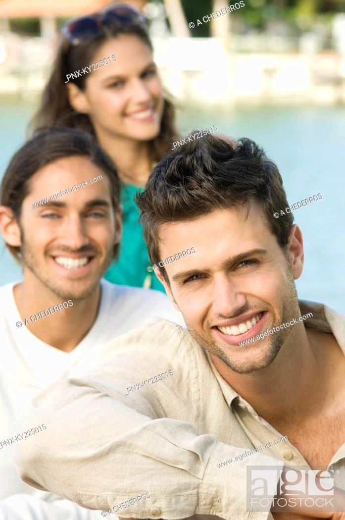 Stock Photo: Portrait of three friends smiling.