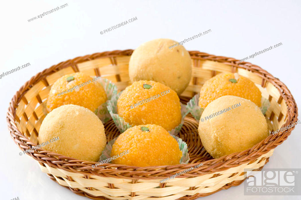 Stock Photo: Close-up of Ladoos in a basket.