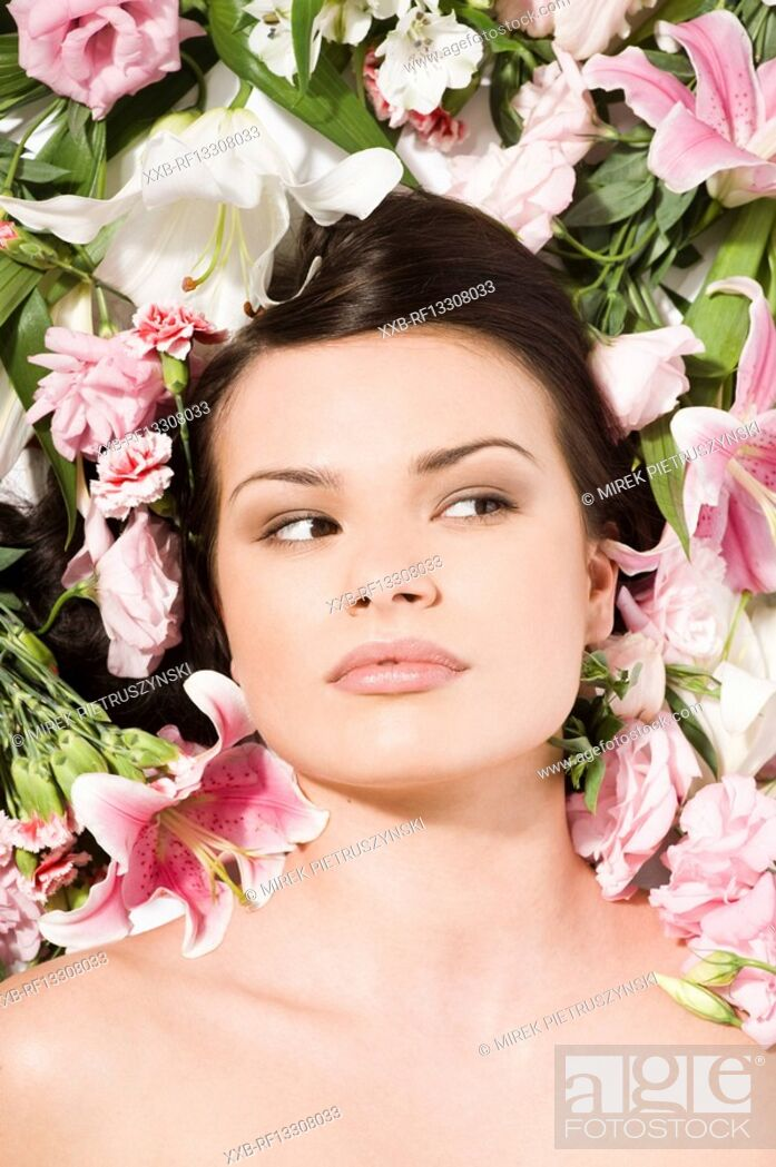 Stock Photo: woman in flowers.