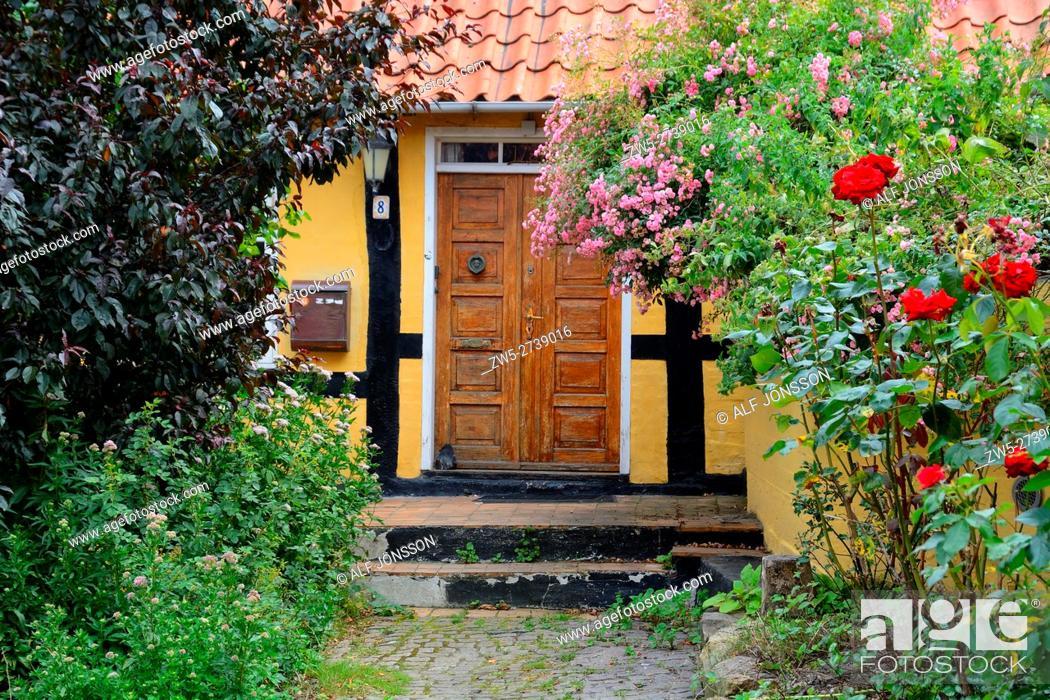 Stock Photo: Entrance among flowers in Gudhjem, Bornholm, Denmark.
