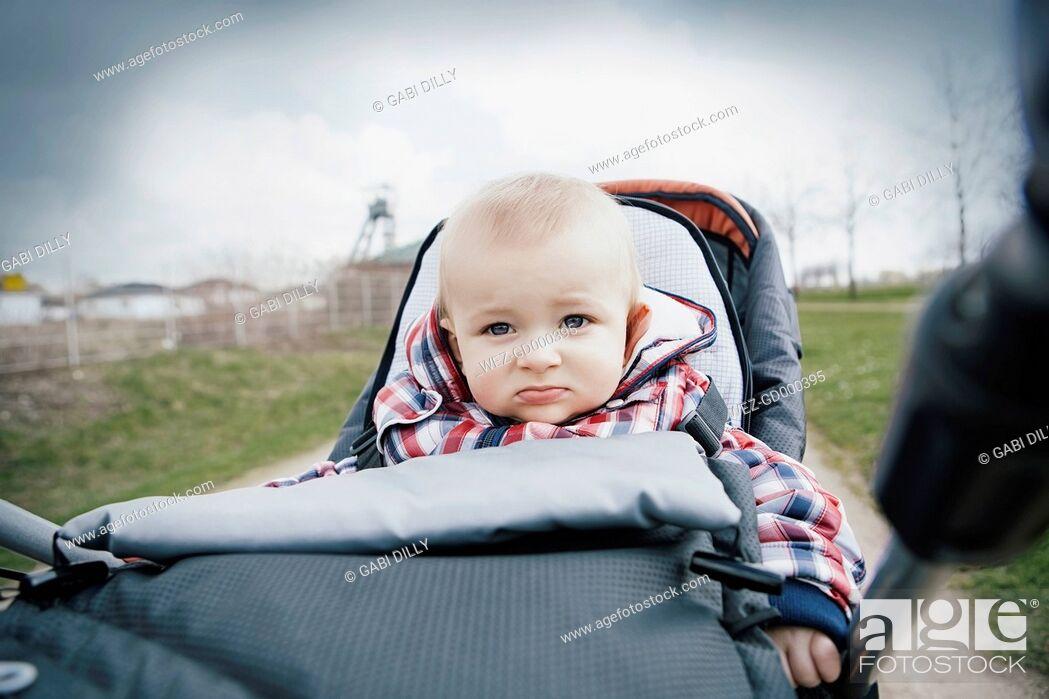 Stock Photo: Germany, Oberhausen, Blond baby boy sitting in pram.