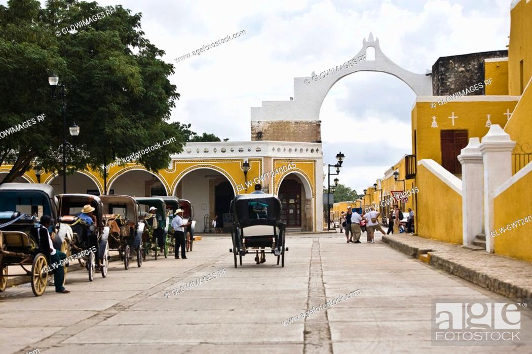 Stock Photo: Horse carts in front of a church, Convento De San Antonio De Padua, Izamal, Yucatan, Mexico.