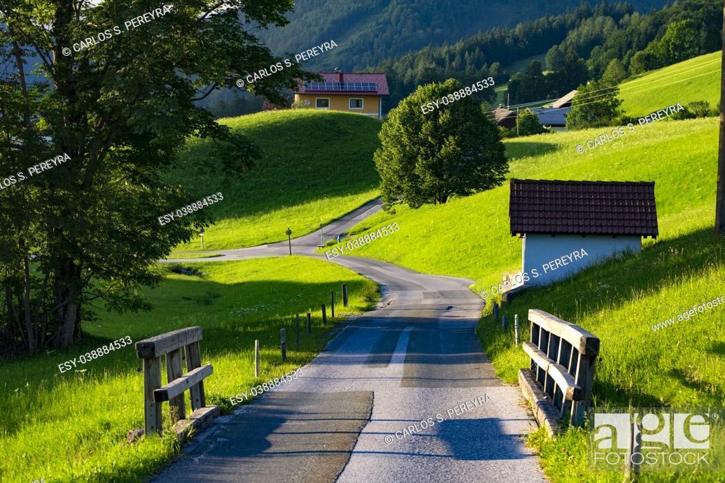 Stock Photo: rustic road in a farm region in the Austrian Alps.