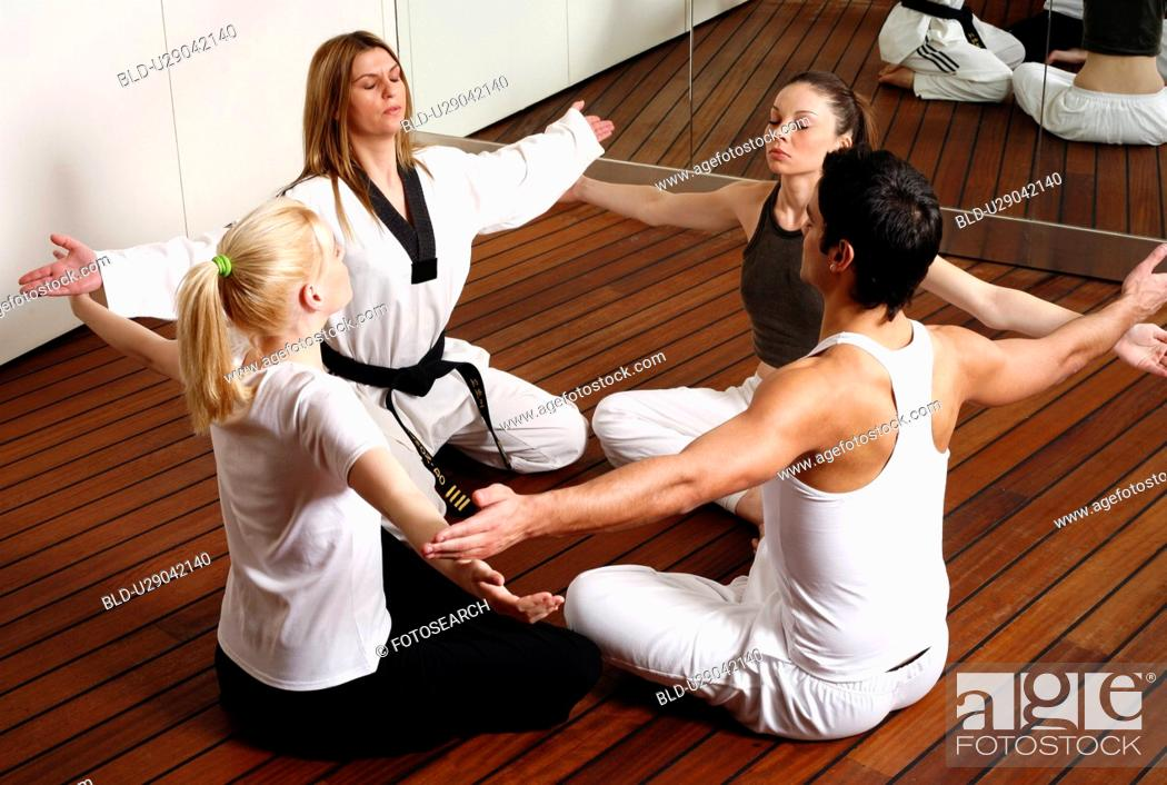 Stock Photo: Participants in a fitness class practicing breathing exercises.