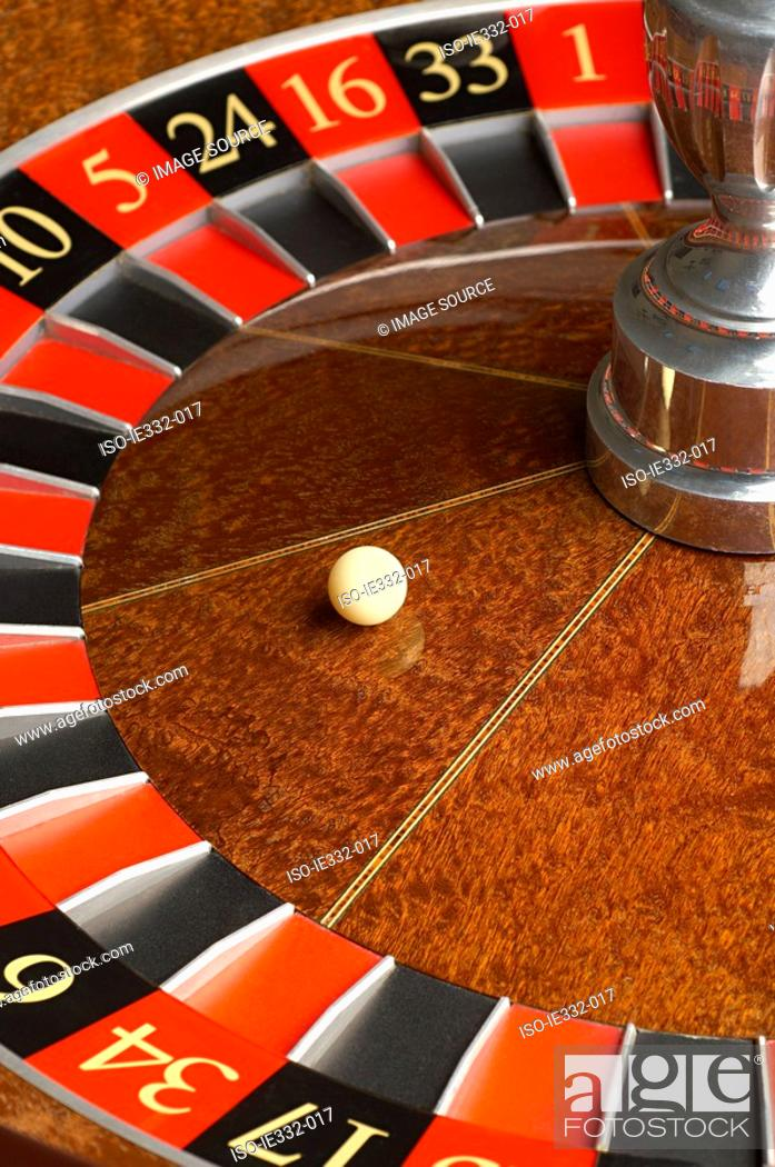 Stock Photo: Roulette wheel and ball.
