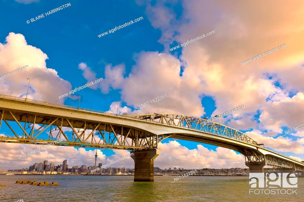 Stock Photo: Auckland Harbour Bridge with the skyline of Auckland in background, Auckland, New Zealand.