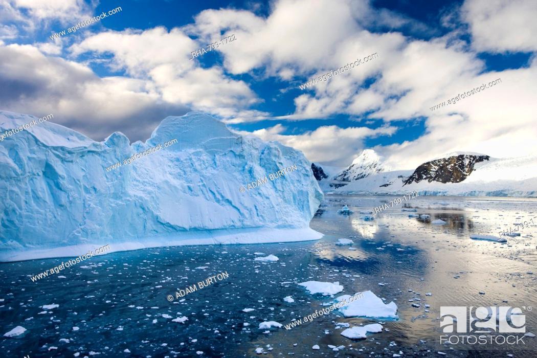 Stock Photo: Icebergs, brash ice and mountainous terrain on the Gerlache Strait, Antarctic Peninsula, Antarctica, Polar Regions.