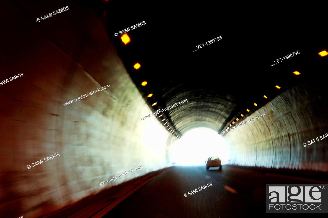 Stock Photo: Car travelling inside a highway tunnel, Provence, France.