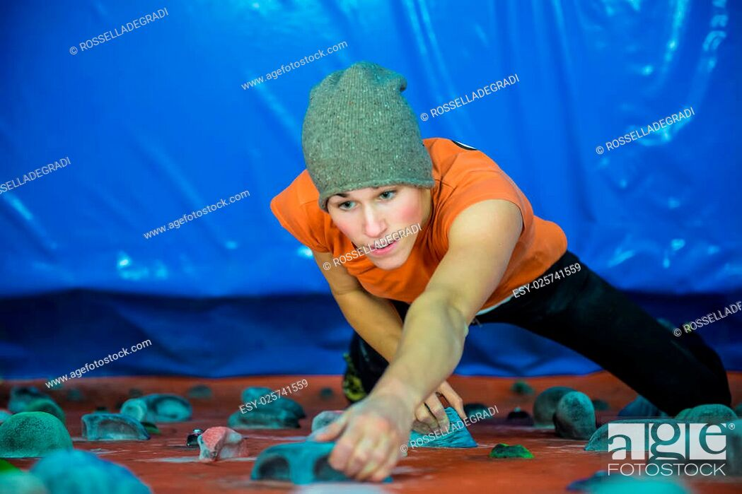 Stock Photo: indoor climbing girl.