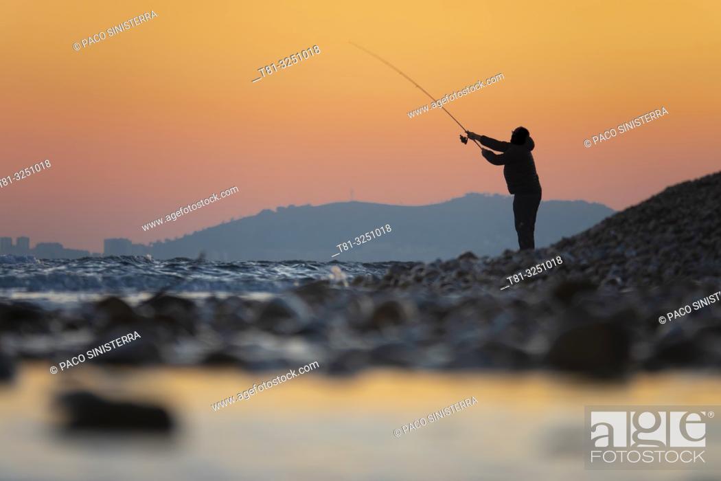 Stock Photo: Fisherman fishing on the beach, Alcocebre Castellon, Spain.