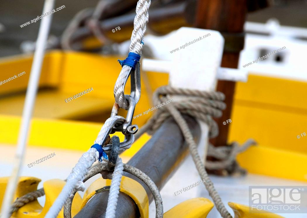 Stock Photo: splices on the prow of a sailboat - close view, shackle, rope and loops.