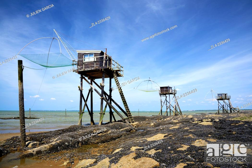 Stock Photo: Traditional carrelet fishing huts with lift nets. France, Loire-Atlantique, Saint-Michel-Chef-Chef, Tharon beach.